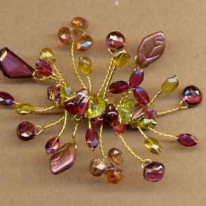 Beaded Branches Pin with garnets and vesuvianite